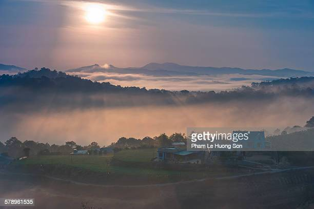 Sunrise above the high mountain foggy valley