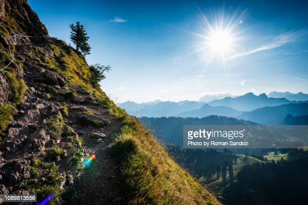 sunrise above the swiss alps - schwyz stock pictures, royalty-free photos & images