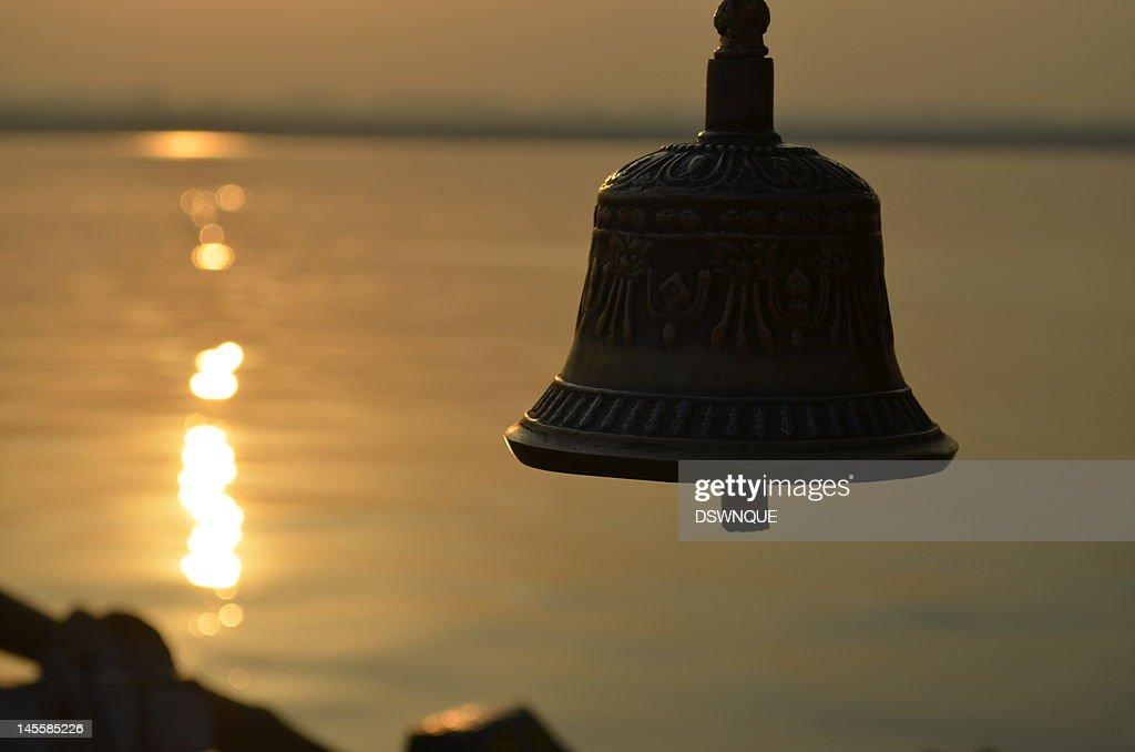 Sunrise against bell : Stock Photo