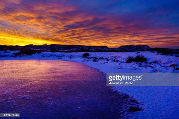 sunrise and frozen pond scenic canyon landscape in winter - fruita colorado stock pictures, royalty-free photos & images