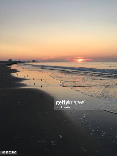 sunrise and surf on the jersey shore - ocean city new jersey stock photos and pictures