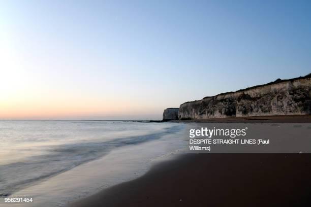 sunrise and the retreating tide - retreating ストックフォトと画像