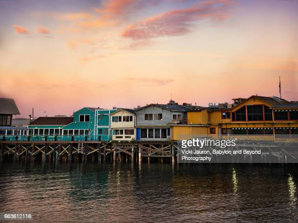 sunrise and wooden buildings of fisherman's wharf in monterey - monterey peninsula stock pictures, royalty-free photos & images