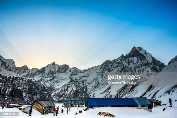 sunrise, annapurna base camp, nepal. - annapurna circuit stock photos and pictures