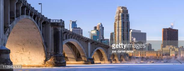 sunrise, arches, central avenue bridge, minneapolis, minnesota, america - minnesota bildbanksfoton och bilder