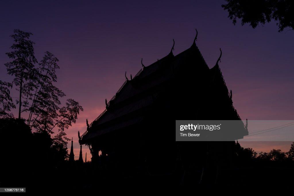 Sunrise at a Buddhist temple. : Stock Photo
