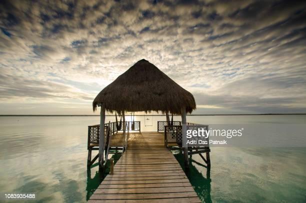 Sunrise at a pier on Bacalar Lagoon