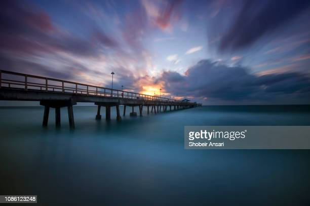 sunrise at anglins fishing pier at lauderdale by the sea, florida - sunrise fort lauderdale bildbanksfoton och bilder