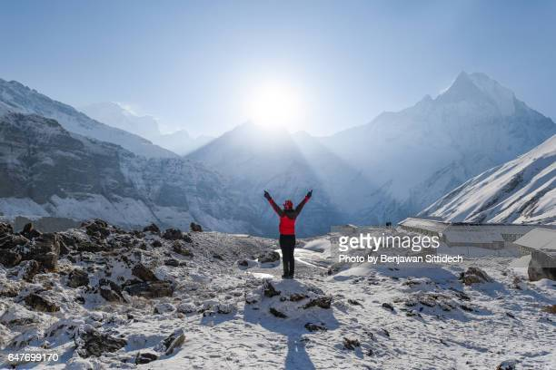sunrise at annapurna base camp, nepal - annapurna conservation area stock photos and pictures