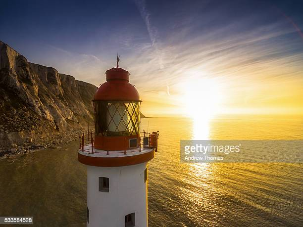 sunrise at beachy head lighthouse - beachy head stock photos and pictures