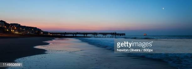 sunrise at boscombe pier - ボスコム ストックフォトと画像