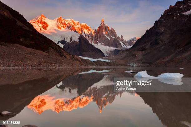 sunrise at cerro torre.  patagonia, argentina - cerro torre photos et images de collection