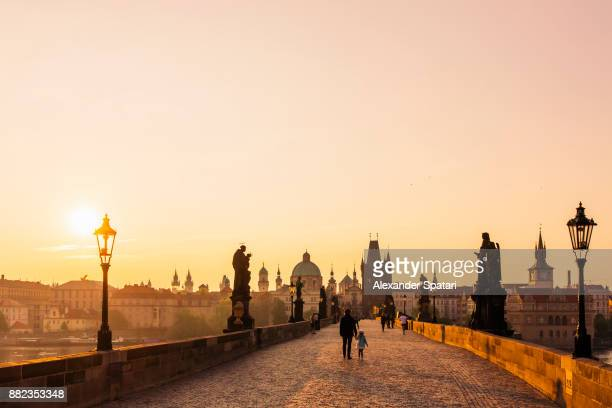 sunrise at charles bridge, prague, czech republic - prag stock-fotos und bilder
