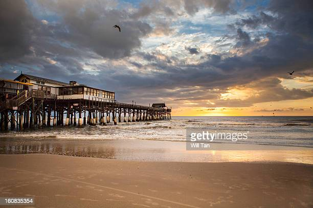 sunrise at cocoa beach pier - cocoa beach stock pictures, royalty-free photos & images
