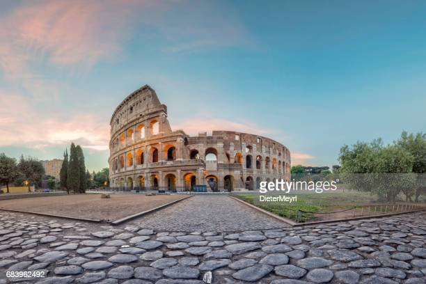 sunrise at colosseum, rome, italy - roma stock photos and pictures