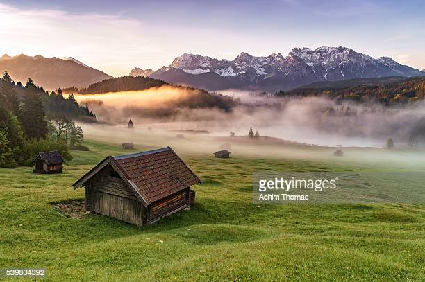 sunrise at famous bavarian lake gerold - mittenwald stock pictures, royalty-free photos & images
