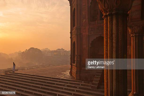 sunrise at jami masjid or grand mosque, india's largest mosque made of black and white sandstone and marble, old delhi, india - friday mosque stock pictures, royalty-free photos & images