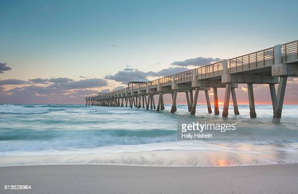 sunrise at juno pier - jupiter florida stock pictures, royalty-free photos & images