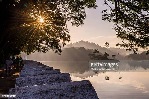 sunrise at kandy lake and the island which houses the royal summer house, kandy, unesco world heritage site, central province, sri lanka, asia - kandy kandy district sri lanka stock photos and pictures