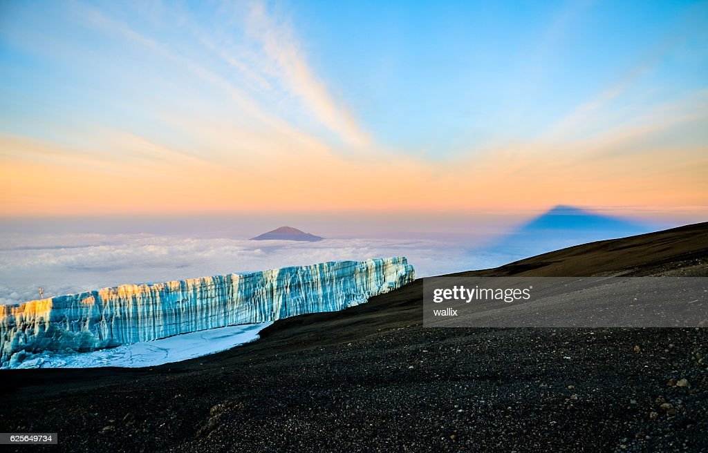 Sunrise at Kilimanjaro with glacier and Mount Meru - Tanzania : Stock Photo