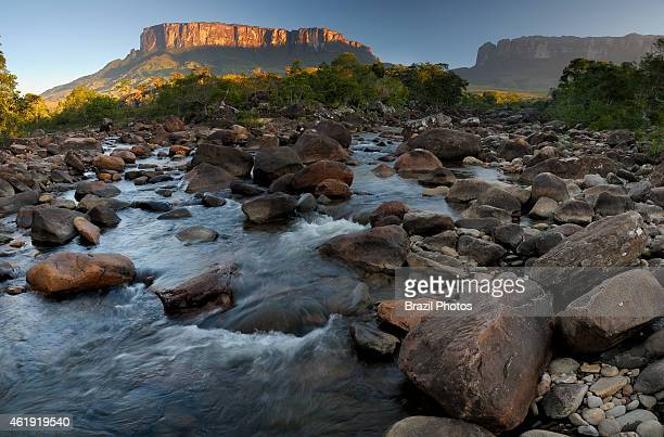Sunrise at Kukenan river Mount Kukenan or Mount Cuquenan at left and Mount Roraima at right in the background in the southeastern corner of...