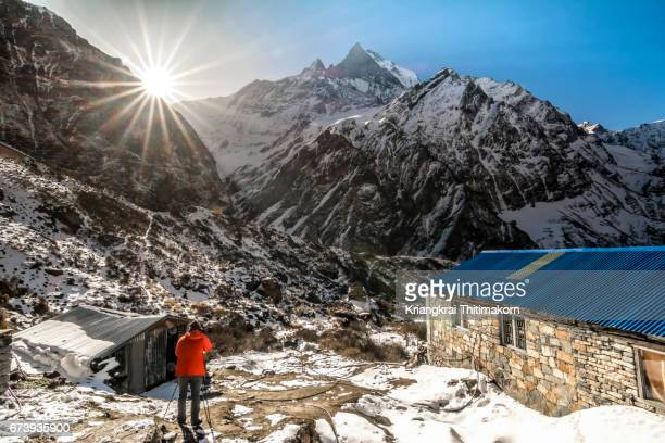 sunrise at machapuchare base camp, nepal. - annapurna south stock photos and pictures