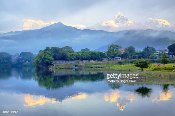 sunrise at pokhara - machapuchare stock photos and pictures