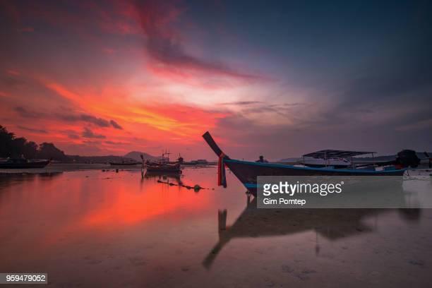 Sunrise at rawai beach pier in phuket , thailand