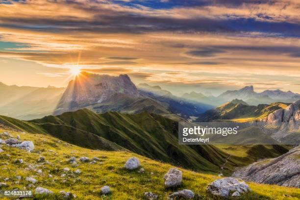 sunrise at sassolungo or langkofel mountain group, dolomites, trentino, alto adige - high section stock pictures, royalty-free photos & images