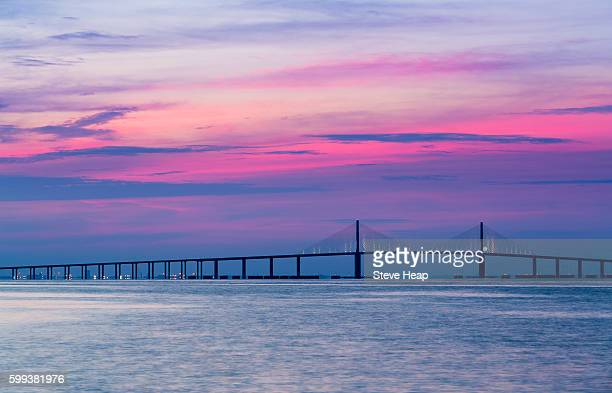 sunrise at sunshine skyway bridge from st petersburg, florida, usa across tampa bay - sunshine skyway bridge stock photos and pictures