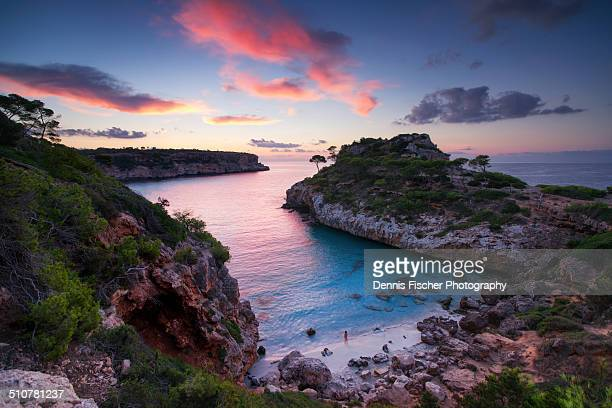 sunrise at the bay cala des moro - majorca stock pictures, royalty-free photos & images