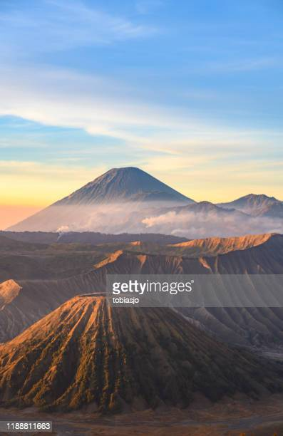 sunrise at the bromo volcano mountain in indonesia - bromo crater stock pictures, royalty-free photos & images