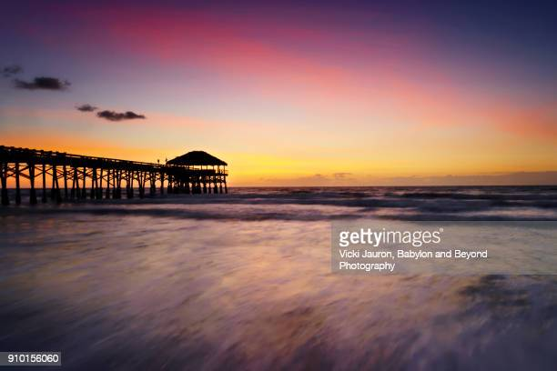 sunrise at the cocoa beach pier in florida - cocoa beach stock pictures, royalty-free photos & images