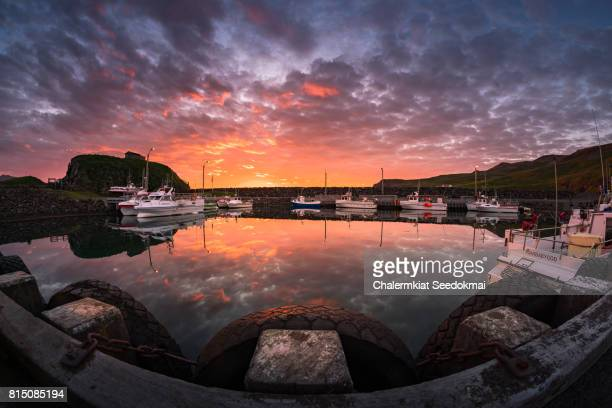 sunrise at the dock in iceland - husavik stock photos and pictures