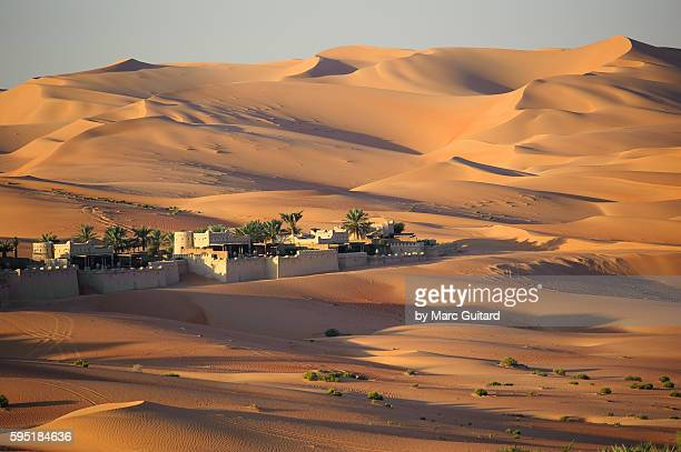 Sunrise at the Qasr Al-Sarab desert resort near Liwa, United Arab Emirates. The luxury resort is nestled in the dunes of the Empty Quarter - a part of the Arabian Desert which covers much of the peninsula.