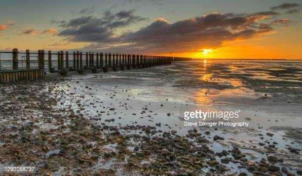 sunrise at the submarine boom - seascape stock pictures, royalty-free photos & images