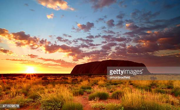 sunrise at uluru in australia's northern territory - uluru stock pictures, royalty-free photos & images