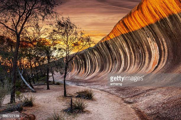 sunrise at wave rock (hyden rock), hyden, western australia - western australia stock photos and pictures