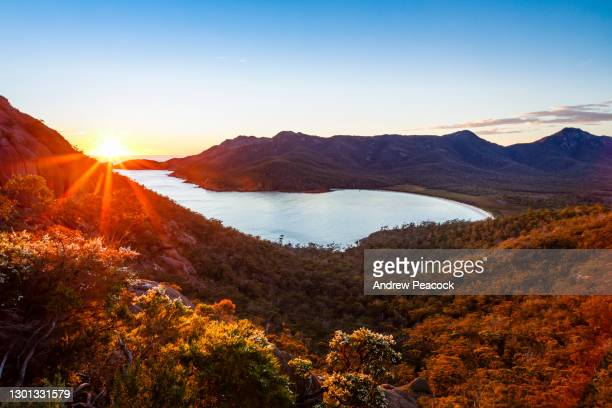 sunrise at wineglass bay lookout, freycinet national park - tasmania stock pictures, royalty-free photos & images