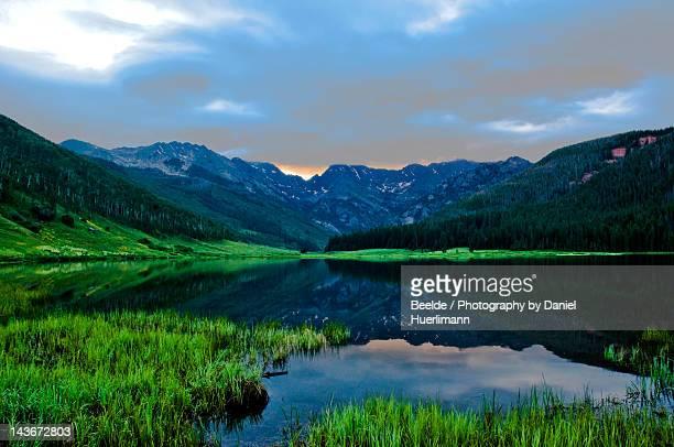 sunrise behind gore range at piney lake - gore range stock photos and pictures