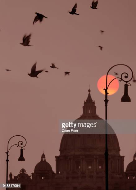 sunrise behind large basilica cathedral. - latium stock pictures, royalty-free photos & images