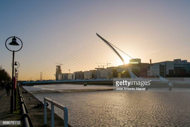 Sunrise behind the Samuel Beckett Bridge in Dublin