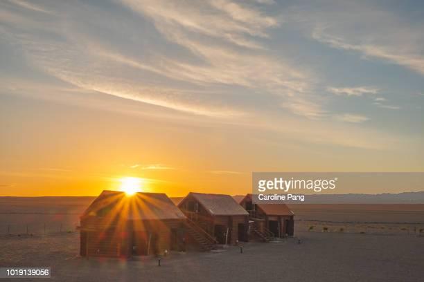 Sunrise behind tourist cabins in the Gobi desert, Mongolia.