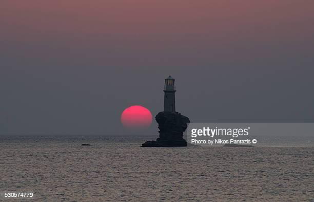 A sunrise beyond the lighthouse