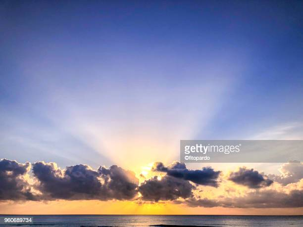 sunrise by the ocean - quintana roo stock photos and pictures