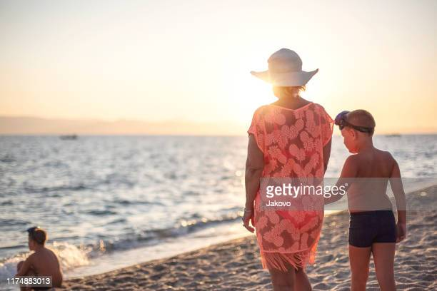 sunrise by the sea - sea swimming stock pictures, royalty-free photos & images