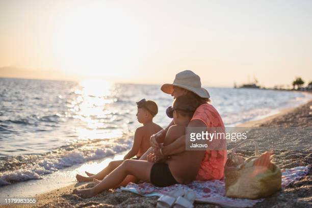 sunrise by the sea - sea swimming stock photos and pictures