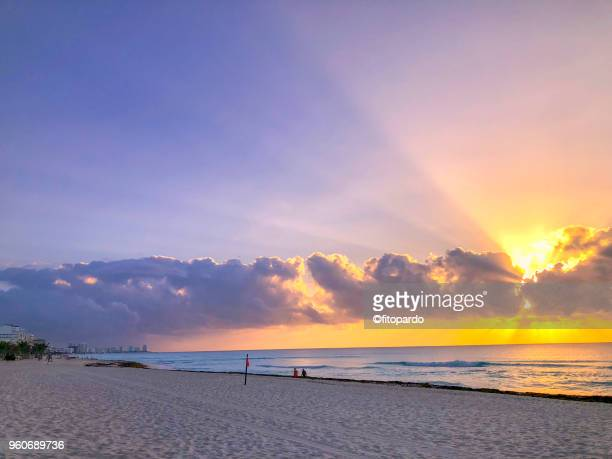 sunrise by the sea - quintana roo stock photos and pictures