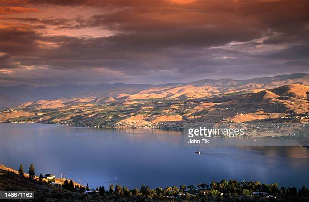 Sunrise casts pastel hues over the city of Chelan and the fjord-like Lake Chelan in the North Cascades region.