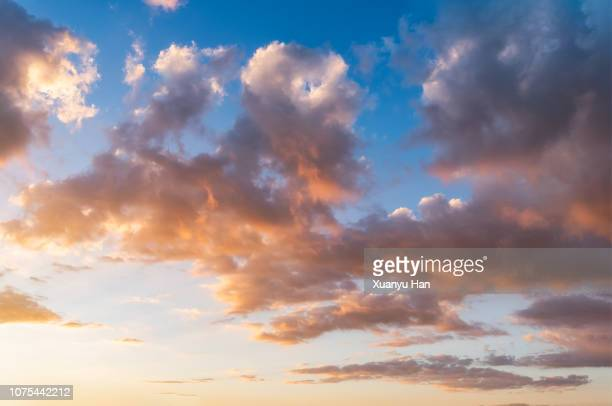 sunrise cloudscape with orange sky - softness stock pictures, royalty-free photos & images